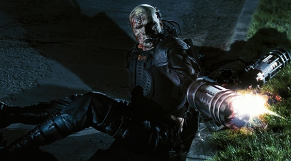 return-of-the-living-dead-necropolis-machine-gun-zombie-robocop-review